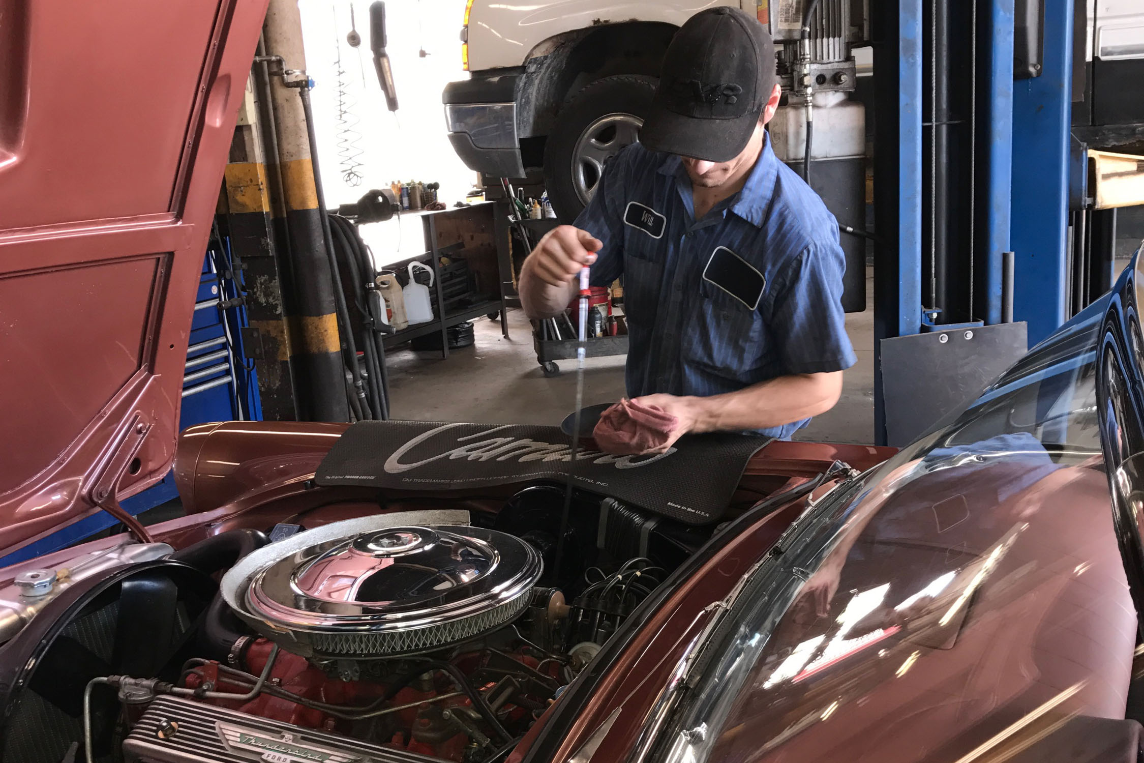 Franklin Mechanic Checking Dip Stick